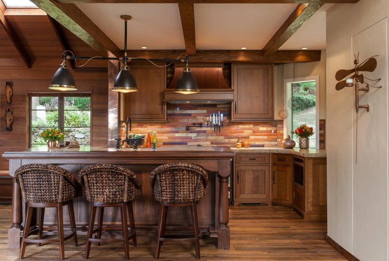 slate backsplash multicolored backsplash rustic cabinet dark wood floor bar stools pendant lights granite countertop exposed beams wood paneled wall