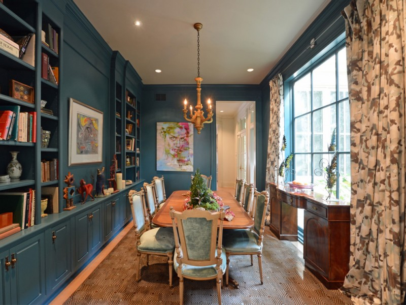 victorian dining table blue built in shelves area rug blue cushioned chairs curtains wooden desk chandelier windows artwork