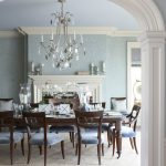Victorian Dining Table Blue Cushion Chairs Chandelier Blue Walls And Ceiling Fireplace White Mantel Wood Flooring Curved Entry