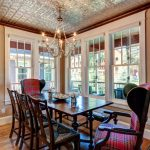Victorian Dining Table Chandelier White Framed Glass Windows Silver Ceiling Patterned Chairs Brown Wall Wood Flooring