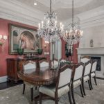 Victorian Dining Table Pearls Chandeliers Pink Walls White Dove Chairs Area Rug Wall Sconces Fireplace Arched Entry Mirror Molded Ceiling