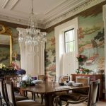 Victorian Dining Table Wall Landscape Mural Crystal Chandelier Mirror With Gold Frame Beige Dining Chairs White Molding