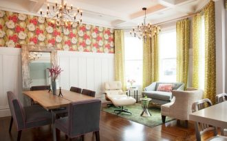 vintage settee custom dining chairs bold floral wallpaper chandeliers windows curtains dining table and cushioned chairs