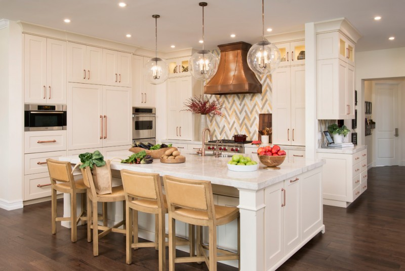 yellow and grey decoration backsplash range hood glass pendant lights white cabinets and island barstools white countertops