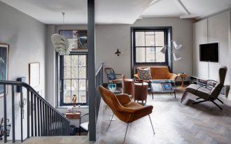 70's furniture chandelier white floor lamps orange and grey leathered armchairs windows glass coffee table stools herringbone floor