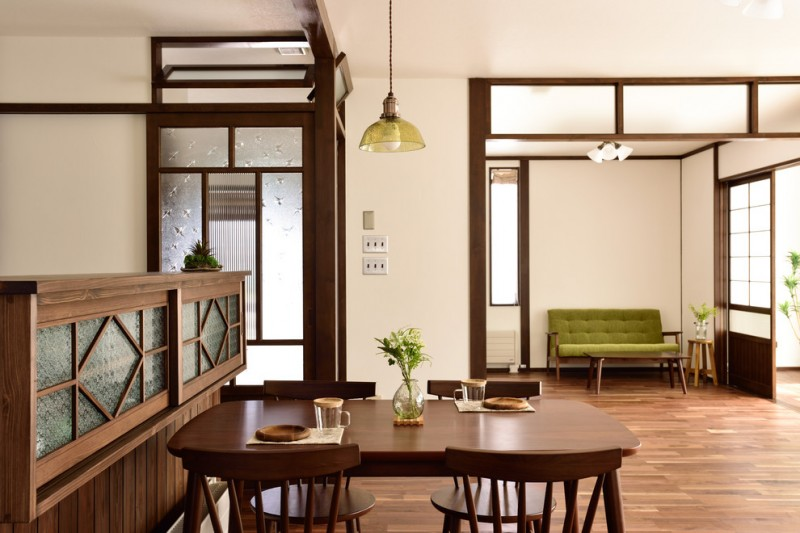 asian dining table wooden dining table wooden chairs wooden floor pendant lamp frosted glass doors and windows green seating