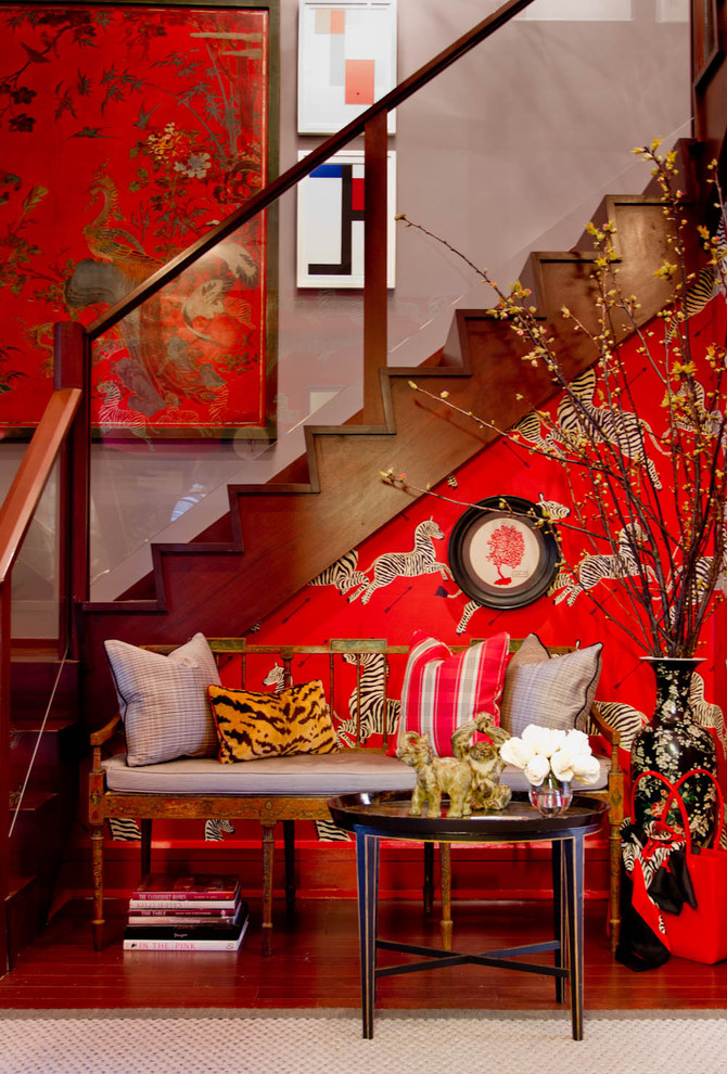 chinese home decorations red framed painting glass railing wood stairs and caps pink wall red patterned wall wood bench coffee table