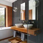 Dark Tiled Wall Pendant Lights Ball Lights Wooden Countertop Wooden Mats Vessel Sink Towel Holder Built In Tub