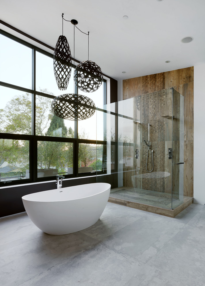 full height glass widow coral pendant lights dark lights freestanding tub shower wall concrete floor