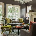Gray Wall Brown Sofa Avocado Throw Sofa Ottoman Coffee Table Rug Area Chandelier Fireplace Marble Mantel Wooden Floor