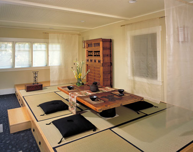 japan style dining table white silk curtains black floor cushions wooden cabinet wooden dining table patterned table runner black tea cups