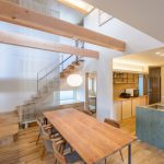 Japan Style Dining Table Wooden Chairs With Grey Cushions Wooden Floor Open Ceiling Pendant Light Kitchen Cabinets Wooden Stairs