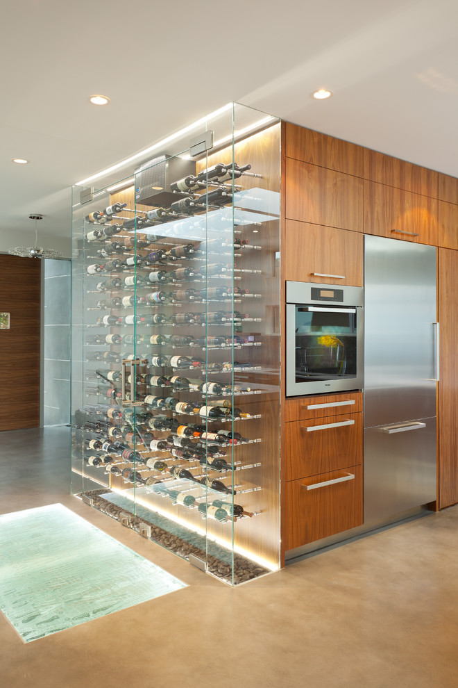modern wine cellar built in oven built in refrigerator beige dloor area rug clear glass wine cellar wooden drawers