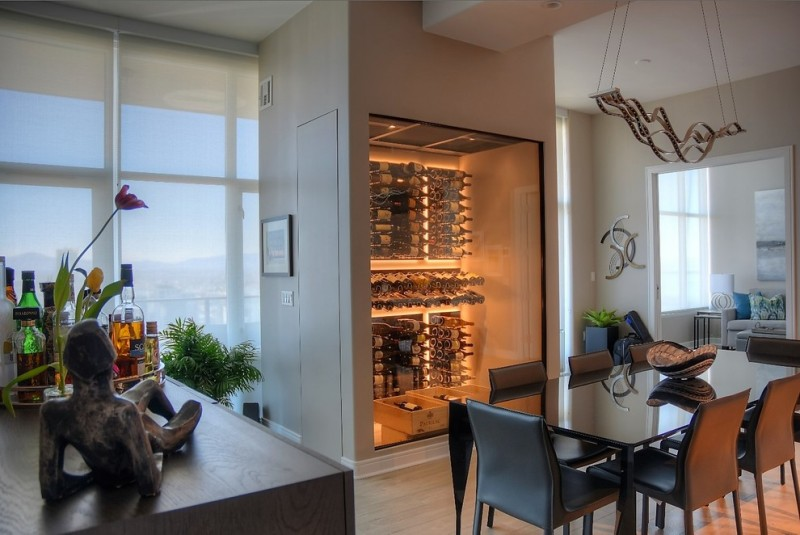 modern wine cellar pendant lamp black dining table black leathered chairs wood vinyl floor wine cellar lighting door
