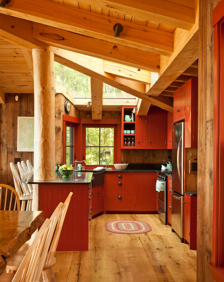 red and black kitchen red cabinets black countertop black sink black stove range hood oven refrigerator windows barstools