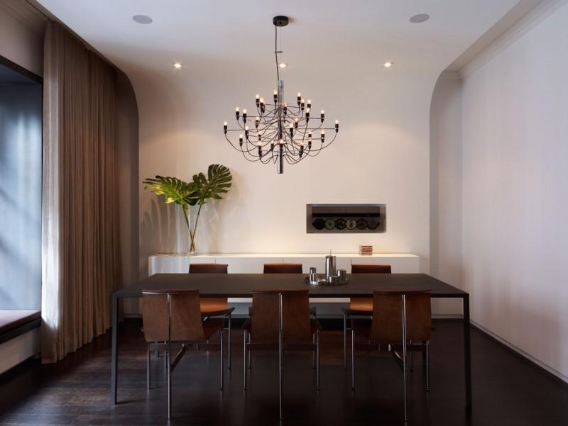 brown dining room chair chandelier minimalist black dining table wall decor white walls white floating buffet window seat curtain dark floor recessed lighting