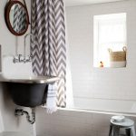 Ceiling Track Shower Curtain Chevron Curtain Hand Towel White Wall Tile Bathtub Window Stool Cowhide Rug Black Tile Sink Mirror