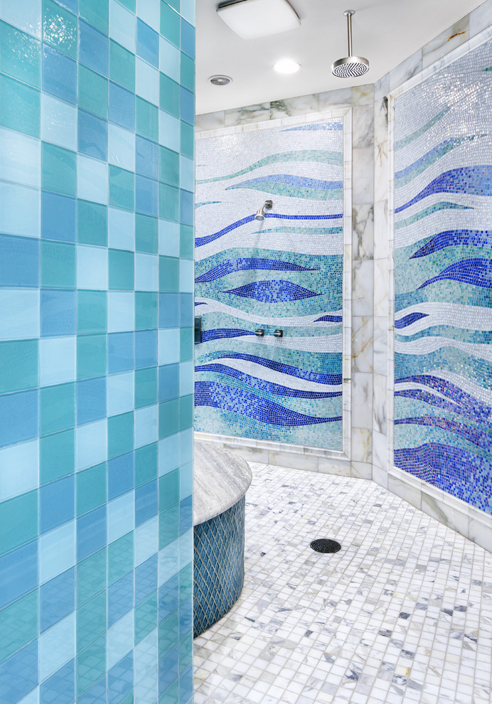 decorative wall tiles blue tiles mosaic blue tiles white floor tiles shower head built in tub recessed lighting sea colored bathroom tiles