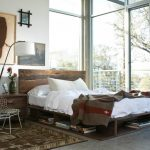 Full Storage Platform Bed Wooden Bed Wooden Headboard Bookshelves Wooden Nightstand Floor Lamp Artwork Windows