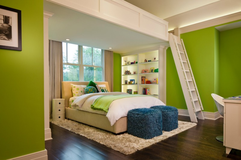 green bedroom walls built in shelves beige bed headboard blue shag ottoman shag rug white desk white chair curtains windows