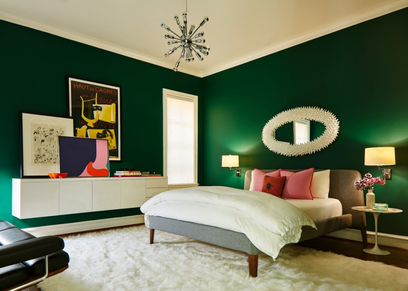green bedroom walls wall mirror grey bed white bedding pink pillows pedestal side table wall sconces floating cabinet white shag rug burst chandelier window