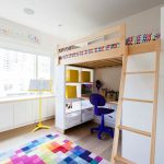 Kids White Loft Bed Colorful Rug Ladder Blue Wheeled Chair Open Shelves Wooden Desk Yellow Basket Table Lamp Window