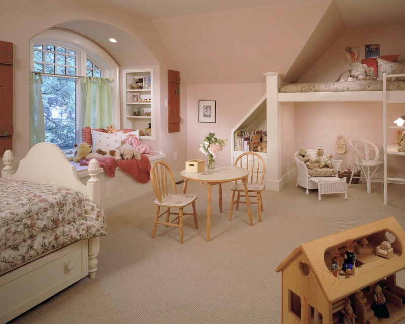 kids white loft bed white bed white window seat wooden table chair pink walls built in shelves white armchair desk window