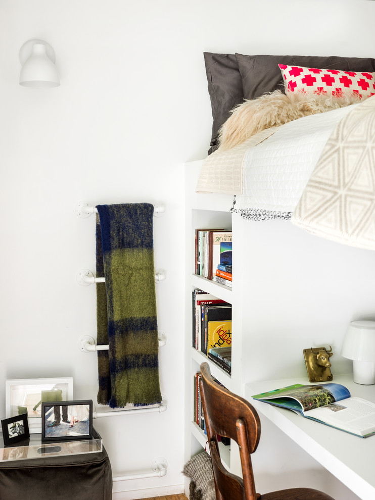 kids white loft bed white wall white wall sconce white rods white built in shelves wooden chair pillows blanket side table