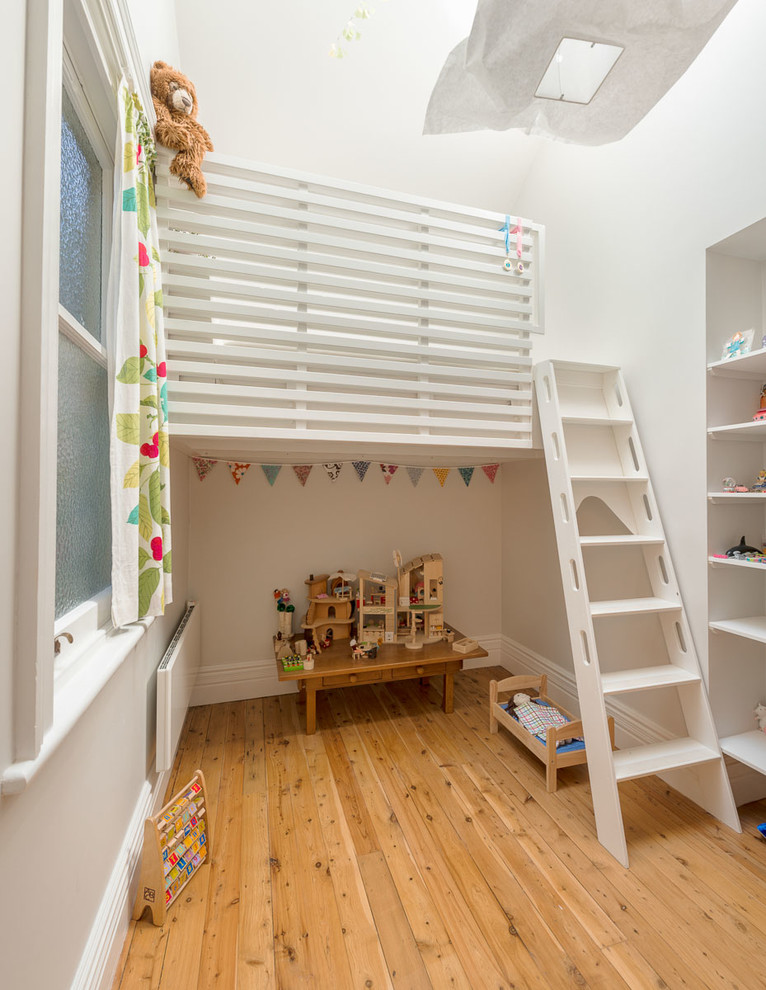kids white loft bed wooden floor ladder recessed lighting windows wooden table built in shelves colorful curtain