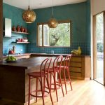 Kitchen Stool Circle Pendant Lamps Red Stools Wooden Island Wooden Countertops Cabinets Green Walls Blue Backsplash Tile Stove Range Hood Sink Foldable Window Glass Doors
