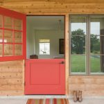 Red Door Designs Glass Grid Doors Glass Windows Wooden Reclamed Wall Grey Concrete Floor Pedant Lamp Colorful Outdoor Mat