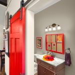 Red Door Designs Sliding Barn Door Black Hardware Red Grid Mirror Wall Sconce Wooden Vanity Glass Sink Bowl Marble Countertop Towel Ring