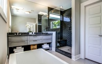 regal glass black shower wall tile glass door mirror granite countertop drawers undermount sink towels basket floor tile