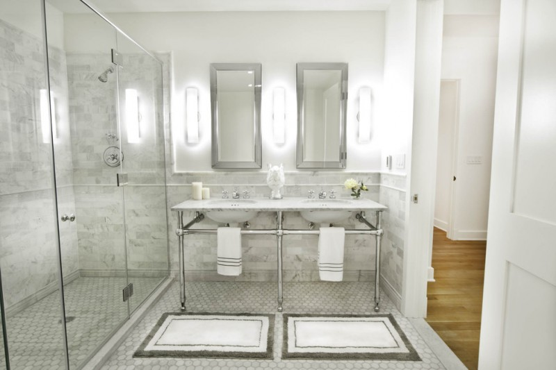 regal glass granite tile glass shower door shower head bathroom mat towels mirrors wall sconces white sinks mosaic floor tile