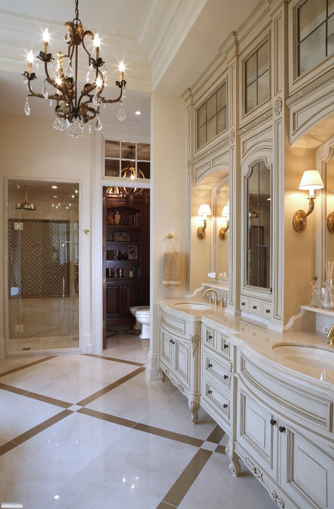 regal glass shower glass country vanity sink gold faucets wall sconces floor tile mirrrors antique chandelier cabinet