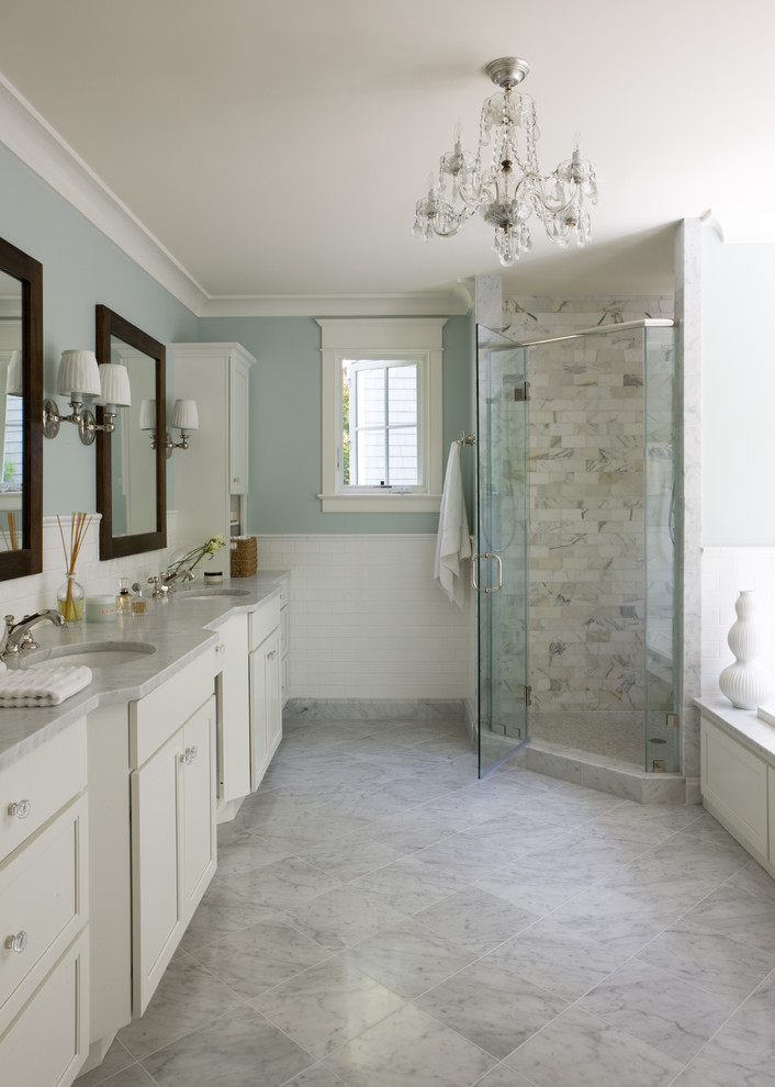 regal glass shower tile glass wooden framed mirrors white vanity blue wall white trim floor tile window sink wall sconces