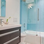 Sliding Glass Shower Door Blue Shower Wall Tiles Mirror Shower Head White Tub Toilet Marble Floor Vanity Sink Faucet