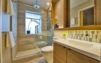 sliding glass shower door frosted glass window rain shower head towel holders wooden vanity white sink mirror backsplash