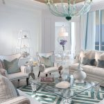 Small Coffee Table Glass Chandelier Glass Coffee Table Blue And White Area Rugs White Sofas White Armchairs Silver Side Table