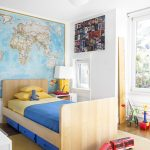 Toddler Boys Bed Map Blue Nylon Storage Wooden Bed Blue And Yellow Bedding White Wall Brown Area Rug Table Lamp Window