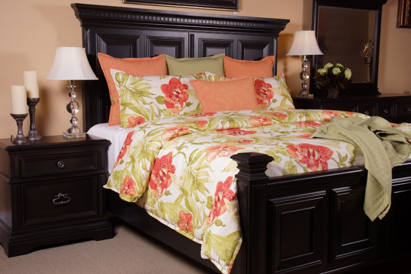 watercolor duvet coral floral bedding black wooden bed headboard green throw nightstands table lamps pillows