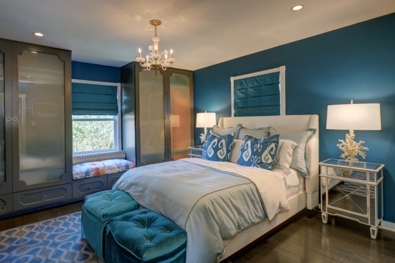watercolor duvet teal wall blue shade chandelier white bed mirrored nightstands sculptural table lamps tufted stools pillows