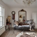 Antique Queen Bed Cowhide Rug Wooden Floor Wall Mirror Clock Table Lamp Grey Bedding Crystal Chandelier Glass Windows Wooden Desk