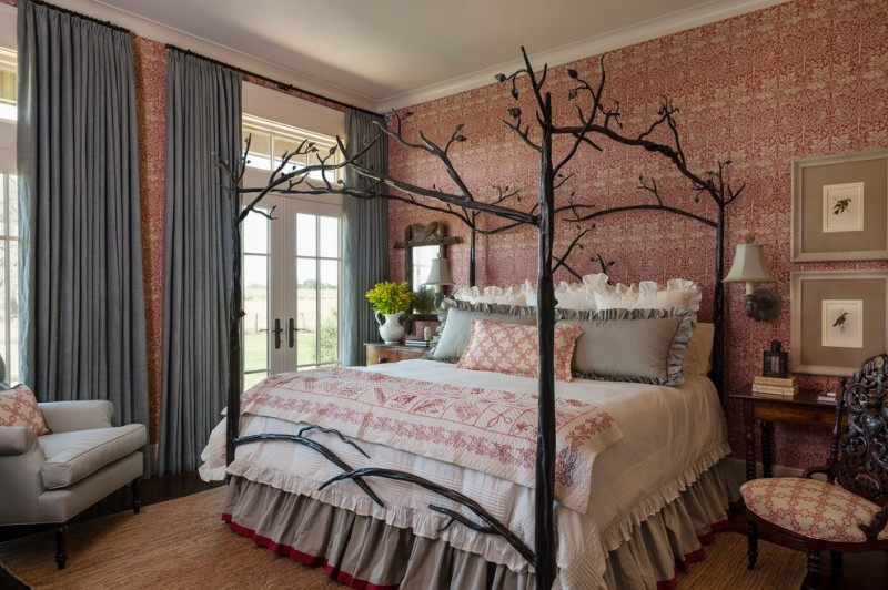 antique queen bed pink patterned wallpaper white and grey bedding wall mirror wall sconces french doors side table armchair grey curtains