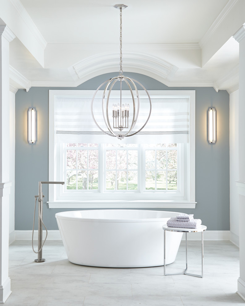 antique silver pendant light freestanding tub white side table tub filler wall sconces grey and white walls white framed glass windows