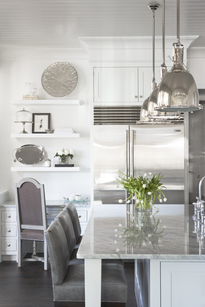 antique silver pendant light refrigerator white cabinets white island granite countertop grey barstools sink faucet white desk white wall mounted shelves