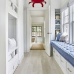 Bedroom With White Bunk Bed, White Wooden Floor, White Wooden Cabinet Under Blue Cushion, Red Crab Accessory