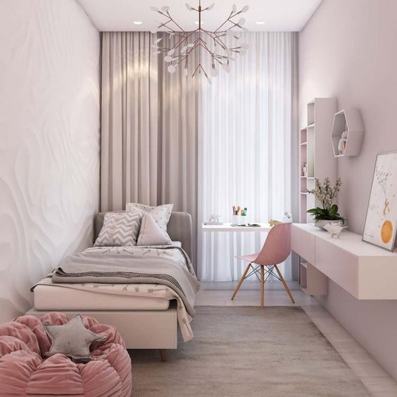 bedroom with white embossed wall, pink bean bacg, pink chair, white table, white shelves, white small haning cabinet, soft pink curtain
