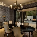 Black Dining Table Beige Dining Chairs Black And White Patterned Wallpaper Mirrored Cabinet Chandelier Sliding Glass Doors Curtains