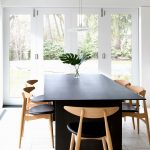 Black Dining Table Wooden Dining Table With Black Leathered Cushions White Industrial Pendant Lamps White Floor Tile White Framed Glass Doors
